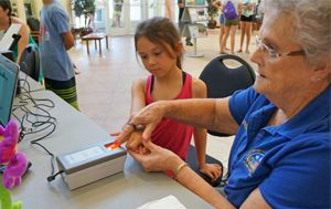 Child Getting Fingerprinted by PD Volunteer