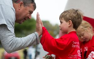 Little boy receiving a high five from a man