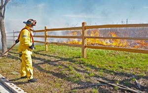 Flower Mound firefighter working during a prescribed burn of The Flower Mound