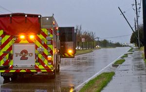 Flower Mound EMS vehicle on the road next to a down power line