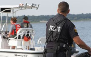flower mound police officer on a jet ski looking at a boat in the water