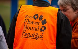 Keep Flower Mound Beautiful orange jacket