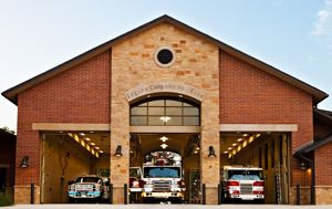 photo of the outside building of Flower Mound Fire Station No. 5 with fire trucks lined up inside th