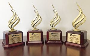 Four national communication trophies lined up in a row