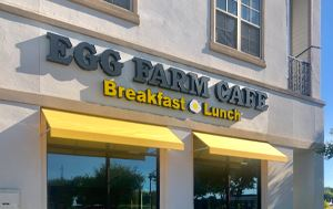 outside view with signage of the restaurant the Egg Farm Cafe