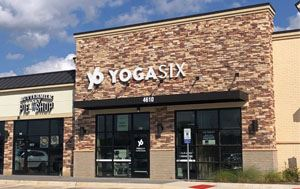 outside view of the YogaSix building in Flower Mound