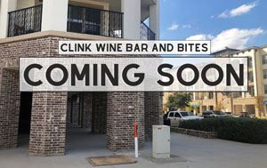 "An empty shop in the background with text saying ""Clink Wine Bar and Bites Coming Soon"""