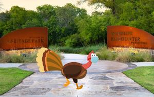 Cartoon turkey walking in front of the Flower Mound Heritage Park signage