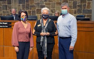 Angie Cox, Carol Kyer, and Mayor Steve Dixon posing for a photo with masks on