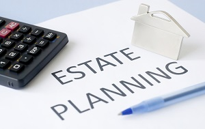 Estate planning with calculator and pen