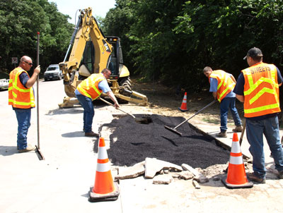 Street Services team works to make a street repair